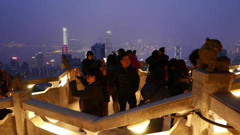 Tourist on Victoria Peak observation deck, night city... Stock Video Footage