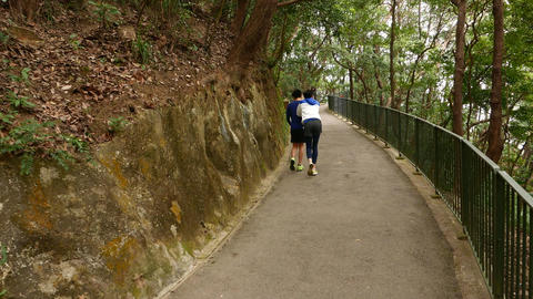 Walking up the hill pathway, following two boys Stock Video Footage