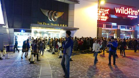 Huge queue to peak tram in the night. People queue up,... Stock Video Footage