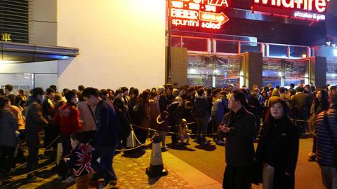 People crowd in queue to Peak Tram at top station, dark... Stock Video Footage