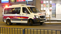 Police minibus with flashlight, turn and drive away Footage
