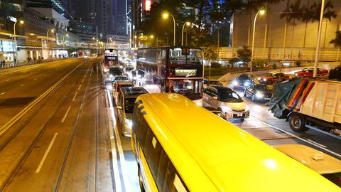 Slow traffic on the night street. Overtake traffic jam Stock Video Footage