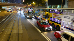 Slow traffic on the night street. Overtake traffic jam Live Action
