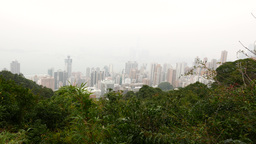 Fast view of the modern city down the mountain, forest and nature view Footage