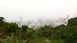 Fast view of the modern city down the mountain, forest... Stock Video Footage