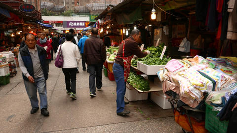Man selling green kitchen herbs on vegetable market Stock Video Footage
