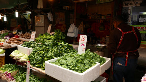 Man selling green kitchen herbs on vegetable market Footage