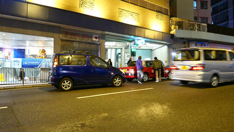 Small accident on the night street, view from opposite side Stock Video Footage