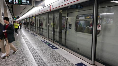 Doors close and metro train departure, glass walls at... Stock Video Footage
