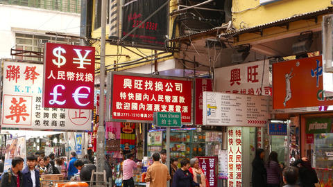 Many different singboard on typical shopping street of Hong Kong city Footage