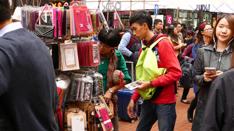 Young asian choosing phone cover on the market Stock Video Footage