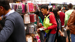 Young Asian Choosing Phone Cover On The Market stock footage