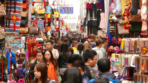 People swarm on the open-air market street in HongKong Stock Video Footage