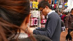 Man Choose Phone Case On The Street, Open Bazaar stock footage