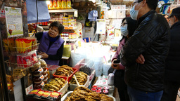 Couple choosing spices in the market, fish section Footage