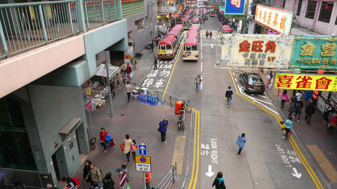 City street from top point, minibus parking far away, pedestrian crossing road Footage