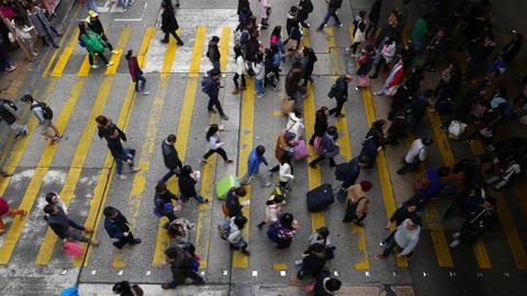 Pedestrians cross zebra at peak hour, top view, crowded crosswalk Footage
