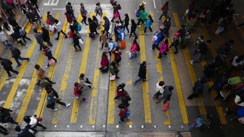 Pedestrians cross zebra at peak hour, top view, crowded... Stock Video Footage