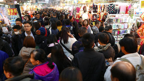 Asian people slowly rush through crowded market street... Stock Video Footage