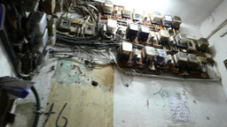 Dirty corridor with electricity counter on the walls,... Stock Video Footage
