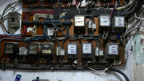 Many electricity meters on wall, dusty and old place Stock Video Footage