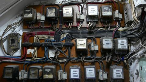 Many electricity meters on wall, dusty and old place Footage
