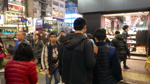 Walking in the crowd on the night street of Hong Kong... Stock Video Footage