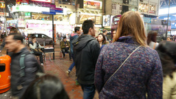 Walking in the crowd on the night street of Hong Kong city, pedestrian crosswalk Live Action