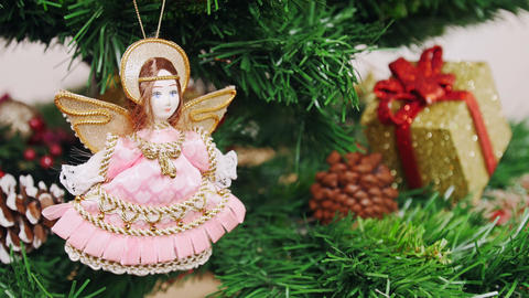 Decoration of Christmas tree angel doll toy. Pan Stock Video Footage