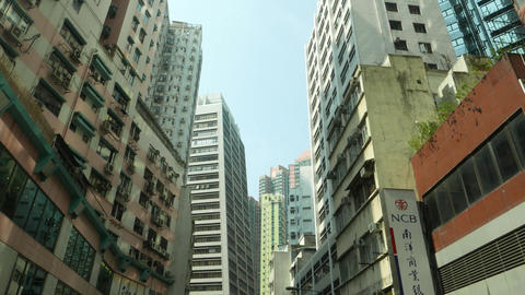 West side of Hong Kong Island, low angle shot of tall buildings and houses Footage