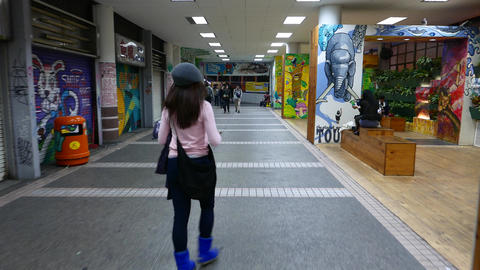 Walking behind the girl in colorful art space, HongKong city Stock Video Footage