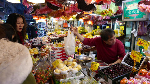 Seller serves clients of fruit and vegetable store in... Stock Video Footage