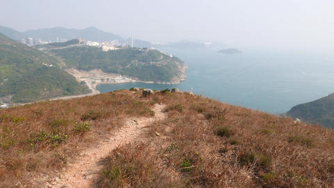 POV walk trodden path at island mountain top, panoramic view Footage