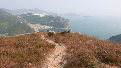 POV walk trodden path at island mountain top, panoramic view Stock Video Footage