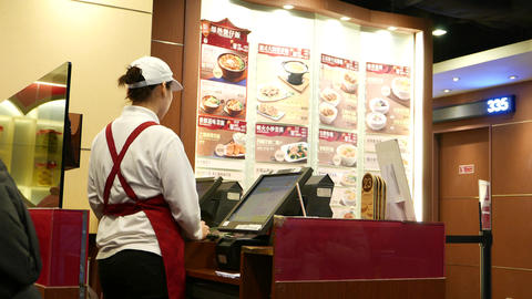 Cashier without clients, agains menu on the wall. Waiting... Stock Video Footage
