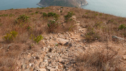 Dangerous climb down of wild track. Path lie down from Ap Lei Chau island peak Footage