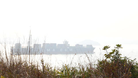 Miracle container vessel on the sea, contrast light, telephoto view Footage