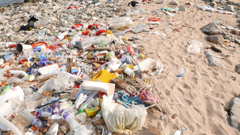 Debris on the very dirty beach, ecological problem, sea pan up many wastes Footage