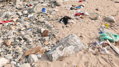 Debris on the very dirty beach, ecological problem, sea... Stock Video Footage