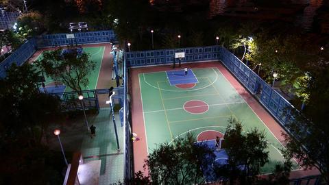 Basketball player alone on night playground field, Ap Lei... Stock Video Footage
