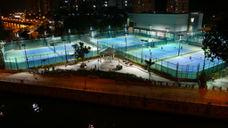Tennis courts illuminated in night, general pan view,... Stock Video Footage