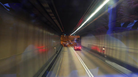 Driving out of the tunnel to the night city highway Stock Video Footage