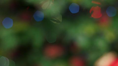 Colorful bokeh of Christmas lights tree. Pan Stock Video Footage