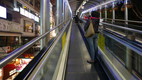 Walking up on the street travellator, night HongKong city Stock Video Footage