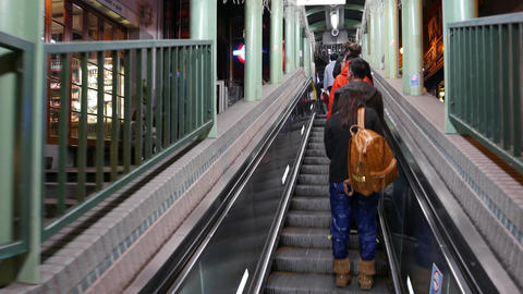 Travelling up on the mid-levels escalator in evening Stock Video Footage
