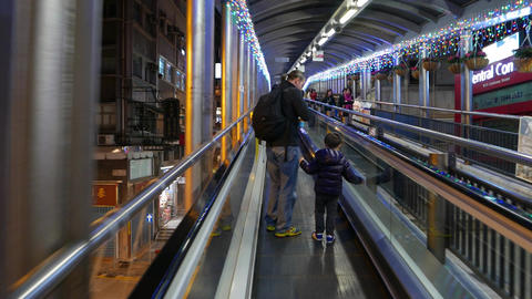 Man and his little son run up on escalator, follow... Stock Video Footage