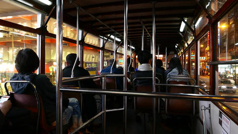 Inside shaky tram drive along night street, view from... Stock Video Footage