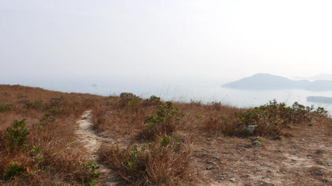 Climb up on top of hill peak at Ap Lei Chau island, POV motion Footage