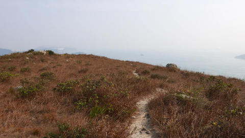 Climb up on top of hill peak at Ap Lei Chau island, POV... Stock Video Footage