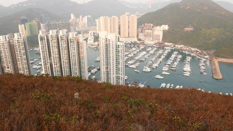 Look down from mountain top, high apartment towers, yachts in bay Footage